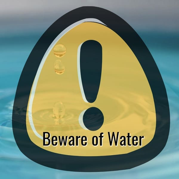 "A signboard of ""beware of water"" with a background of droplets"