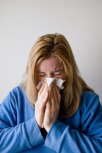 a woman who sneeze who is allergic to pet dander